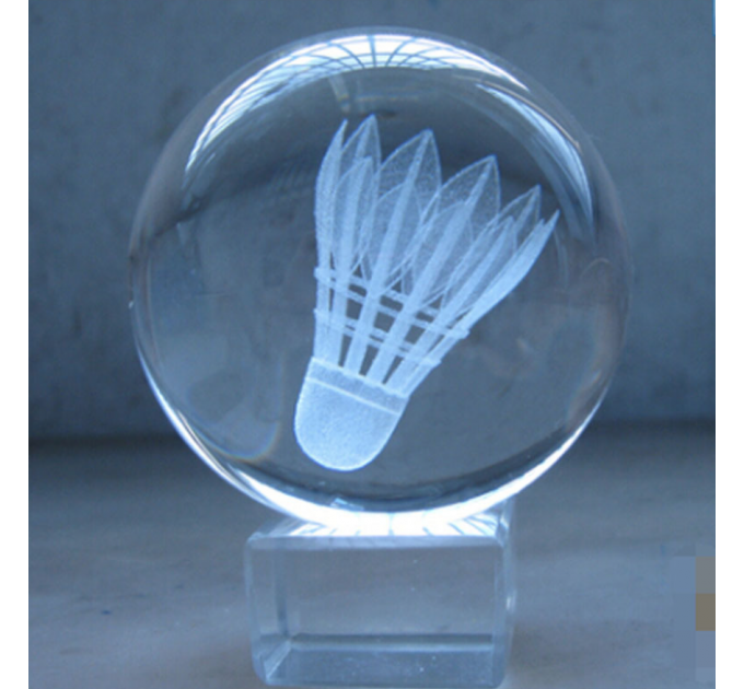 Crystal ball with a shuttlecock